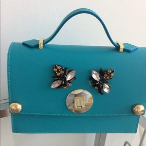 Made in Italy turquoise leather bag w/ bumble bee